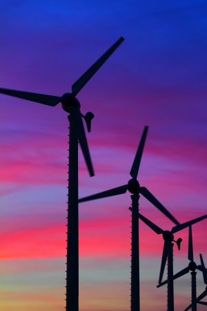 Wind turbine silhouettes at twilight, at Thailand photo