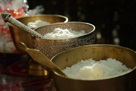 Cooked rice in brass bowl ,The merit of Thais in wedding     Stock Photo