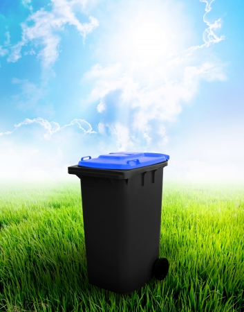 Black And Blue Recycle Bin Ecology Concept With Landscape Background  Stock Photo