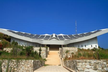 lightbeam: Solar panel building with blue sky