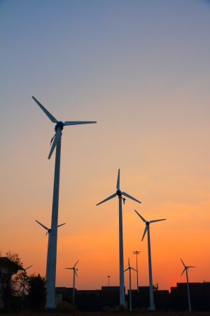Clean energy wind turbine silhouettes at sunset, at Thailand photo