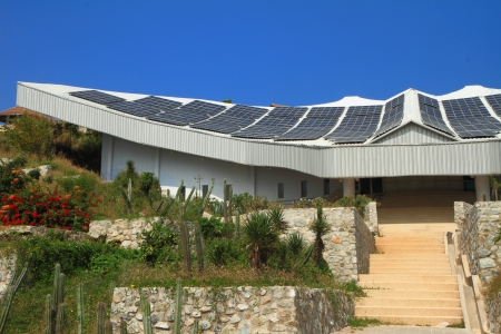solarcell: Solar panel building with blue sky
