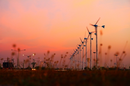 Romantic scene of clean energy wind turbine silhouettes at twilight  photo