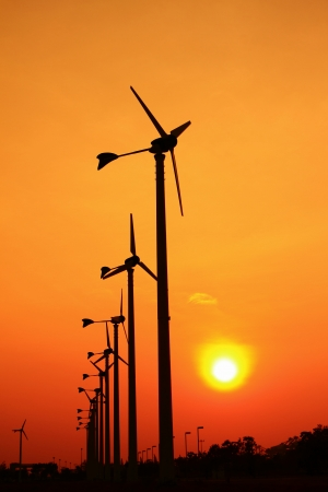 Wind turbine power generator at sunset photo