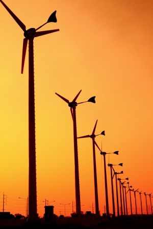 Wind turbine power generator at sunset photo
