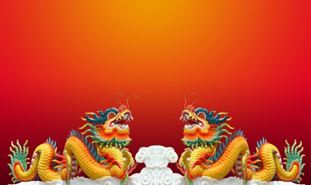chinese new year dragon: Twain chinese dragon statue with red background
