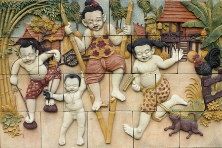 thailand culture: Low relief cement Thai style handcraft games of Thailand culture on wall, artwork for decor