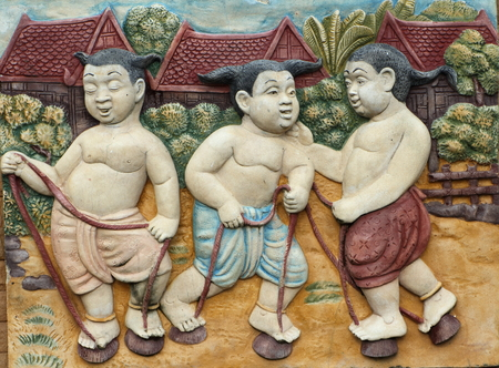 thailand culture: Low relief cement Thai style handcraft games of Thailand culture on wall, artwork for d�cor
