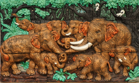 low relief: Low relief cement Thai style handcraft of elephants on wall  Stock Photo