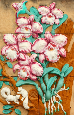 low relief: Low relief cement Thai style handcraft of orchid  on wall  Stock Photo