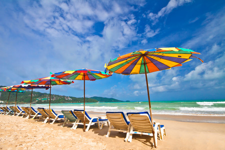Beach chairs and colorful umbrella on the beach Phuket Thailand photo