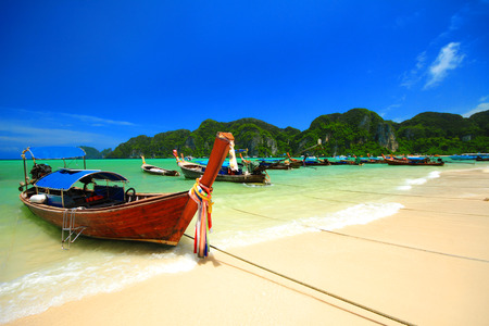 Traditional longtail boat and the clear sea at Phi Phi Don island, Andaman sea of Thailand  photo