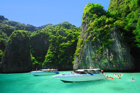 Boats and the clear sea at Phi Phi Leh island, Andaman sea of Thailand  Stock Photo