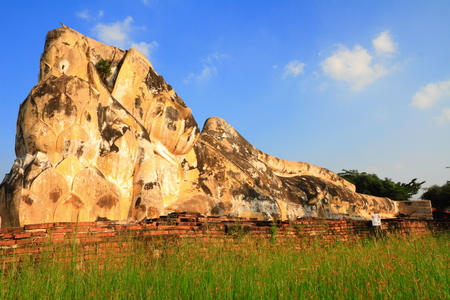 reclining: Reclining buddha in old temple, at  Historic city of Ayutthaya Thailand