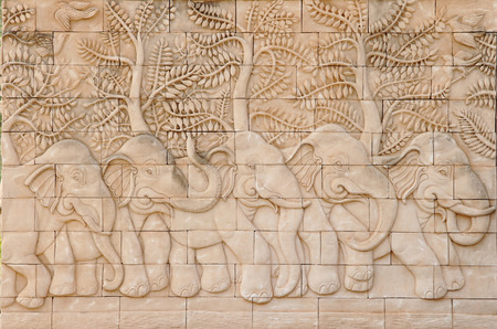 Low relief cement Thai style handcraft of elephant photo