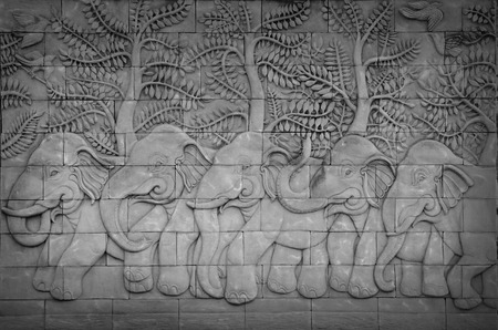 Low relief cement Thai style handcraft of elephant stories  photo