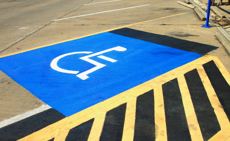 accessible: Disabled parking sign on the floor.