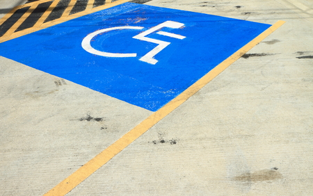 Disabled parking sign on the floor. photo