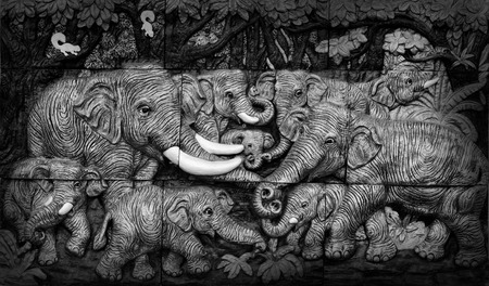 Black and white of low relief cement Thai style handcraft of elephant.