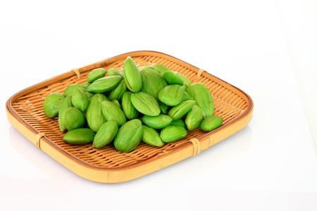 stinking: Tropical stinking edible beans in basket on white background. (Parkia Speciosa) Stock Photo