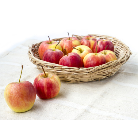 apple sack: Small gala apple in basket on sack over white background.