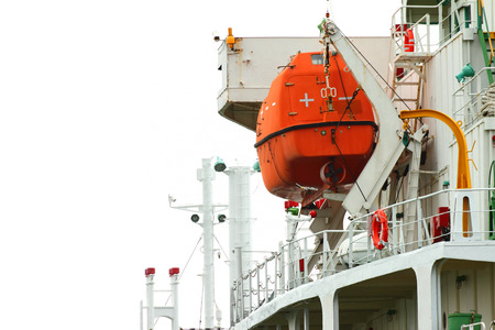Lifeboat hanging on a deck of vessel. photo
