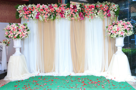 Colorful backdrop flowers with white and gold fabric arrangement colorful backdrop flowers with white and gold fabric arrangement ready for wedding ceremony stock photo mightylinksfo