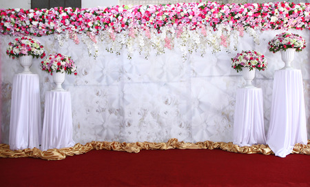 Pink and white backdrop flowers arrangement ready for wedding ceremony.