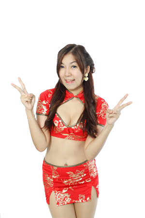 Sexy asian woman dress traditional cheongsam and introduce on white background.
