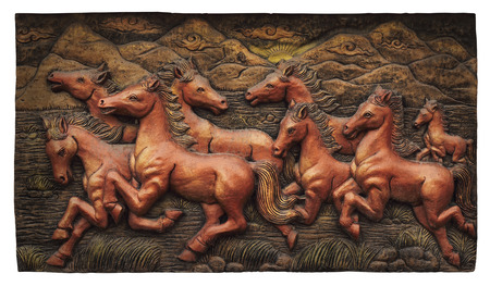 antique asian: Low relief cement Thai style handcraft of horse on wall, cliping path. Stock Photo