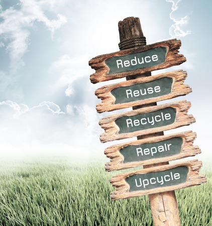 reduce reutiliza recicla: Vintage wooden sign with Reduce, Reuse, Recycle, Repair and Upcycle wording on nature background, ecology concept.