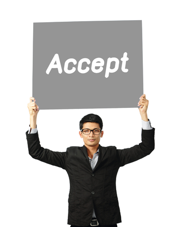 Asia businessman show wording accept on paper board over white background, clipping path.