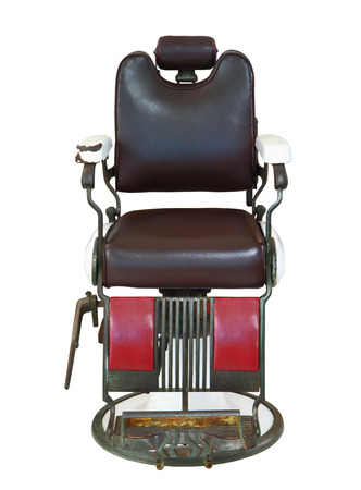 barber: Front view of old barber chair isolated on white background, clipping path.
