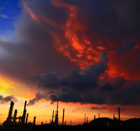 refinement: Petrochemical plant oil refinery with dramatic sky at Thailand. Stock Photo