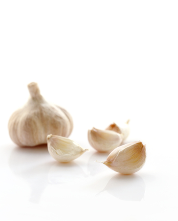 Fresh organic garlic isolated on white background, selective focus. Stock Photo