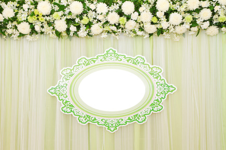 wedding backdrop: Beautiful white and green backdrop flowers arrangement over white fabric ready for wedding ceremony.