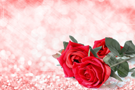 Red roses bouquet with bokeh and free space for text, valentine twinkled bright background.