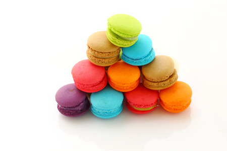 horizental: Colorful macarons on white background.
