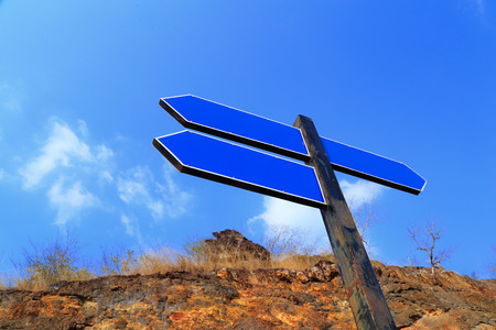 guidepost: An image of blue empty guidepost with nature background. Stock Photo