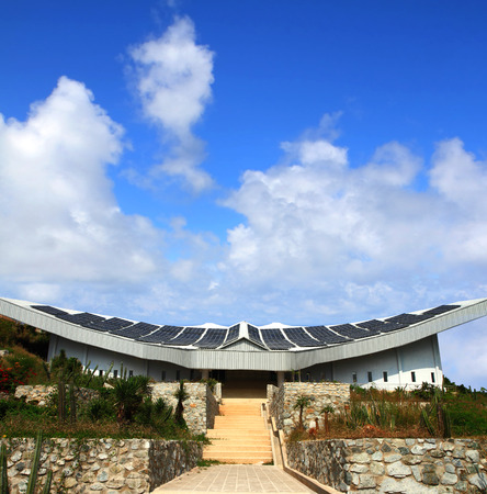 Solar panels on roof of building with blue sky, clean energy at koh lan island Pattaya city Chonburi Thailand. Stock Photo