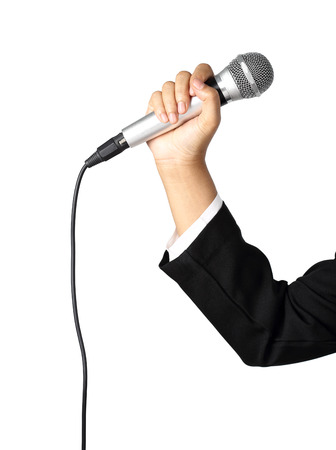 Businesswoman hand holding a microphone isolated on white background,