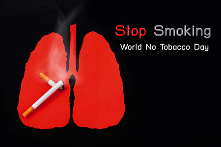 World No Tobacco Day, Cigarette is burning with smoke on lung background.