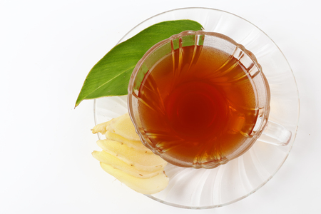 inflammatory: Top view of fresh ginger root and tea isolated over white background.
