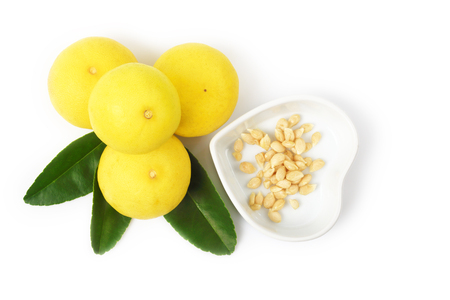 Top view of ripe lemon and leaf with seeds isolated on white background, Frash lemon against cancer. Stock Photo