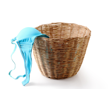 Close up of used female underwear in basket isolated on white background, clipping path. Stock Photo