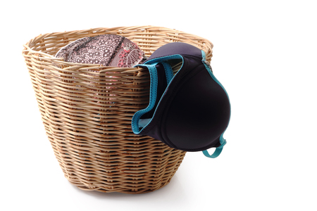washed: Close up of used female underwear in basket isolated on white background, clipping path. Foto de archivo