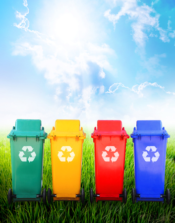 Colorful recycle bins ecology concept with nature background.