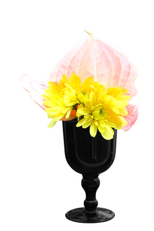 Bright of yellow chrysanthemum and pink flamingo flowers in vase isolated on white background, clipping path.