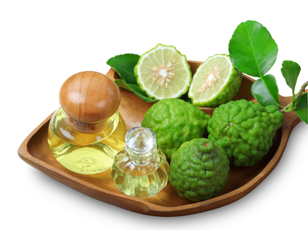Kaffir lime or bergamot with aromatic spa of bottles essential oil isolated on white background, clipping path. Banque d'images