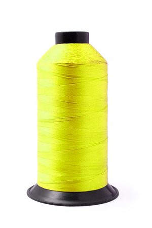 Yellow of industry sewing thread isolated on a white background, clipping path.